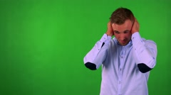 Young handsome business man is afraid (man covers his ears) - green screen Stock Footage
