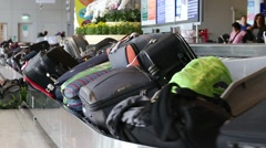 Baggage conveyor belt in Airport carrying passenger luggage. Bangkok, Thailand Stock Footage