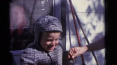 1963: proud baby boy taking hand of mother winter walking CAMDEN, NEW JERSEY Stock Footage