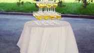 Pyramid from glasses of champagne on wedding party in slowmotion. 1920x1080 Stock Footage