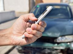 Calling to my insurance car Stock Photos