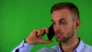 Young handsome business man phones with smartphone - green screen - studio Stock Footage