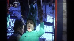 1963: a child is seen behind a glass CAMDEN, NEW JERSEY Stock Footage