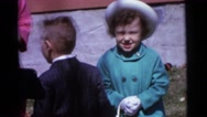 1963: kid wanders around as family struggles to take family portrait CAMDEN Stock Footage