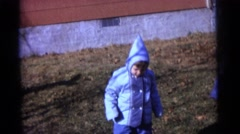 1963: three children in matching outfits, playing in the yard CAMDEN, NEW JERSEY Stock Footage