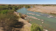 Aerial view of the Orange river flowing through the Northern Cape, South Africa Stock Footage
