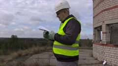Engineer with paper airplane Stock Footage
