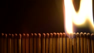 A row of matches is lit. Burns both violently and slowly. 60fps Stock Footage
