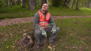 Smiling park employee sitting and showing thumb up Stock Footage