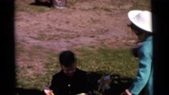 1963: children are seen having fun in a garden area CAMDEN, NEW JERSEY Stock Footage