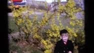 1963: kids by tree waving pinwheels CAMDEN, NEW JERSEY Stock Footage