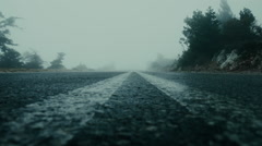 Foggy mountain asphalt road,moody, overcast,slow zoom in Stock Footage