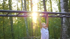 The child climbs on a horizontal ladder Stock Footage