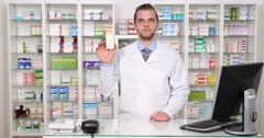 Serious Druggist Male Showing Medicine Thumb Up Hand Gesture in Pharmacy Shop Stock Footage