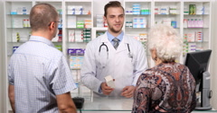 Pharmacist Man Talking Clients Old Woman Medicine Drugs Product Pharmacy Store Stock Footage