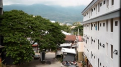 View of a mountain in the distance from a hotel room Stock Footage