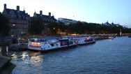 Cruise boats on Thames river in London Stock Footage