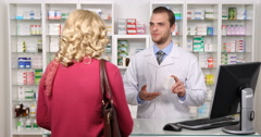 Patient Woman Receiving Info About Medicine Pills Pharmacist Man Talk Pharmacy Stock Footage