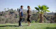 Young woman proposes to boyfriend in urban LA park 4K Stock Footage