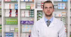 Pharmacy Store Presentation OK Sign Young Pharmacist Man Doctor Looking Camera Stock Footage