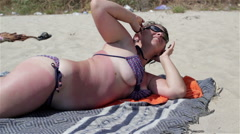 Sexy woman on the beach with beautiful breasts Stock Footage