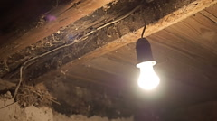 Flashing lightbulb In the old basement of the house Stock Footage