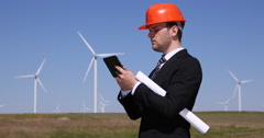Young Businessman Holding Touchpad Device Wind Turbines Field Industrial Area Stock Footage