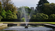Water fountain spraying water in a park, in slow motion  Stock Footage