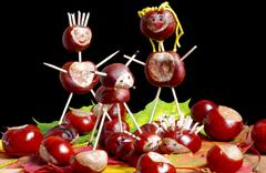 Figurines made from chestnuts Stock Photos