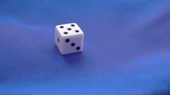 Moving dice on blue background Stock Footage