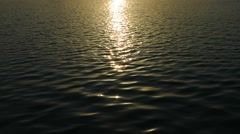 Sunset Light Reflected in the Ripples of a Calm Sea Stock Footage