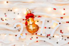 Christmas and New Year background with numbers 2017, decorations and light bu Stock Photos