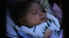 1961: sleepy baby boy DETROIT, MICHIGAN Stock Footage