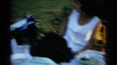 1961: family having a picnic. DETROIT, MICHIGAN Stock Footage