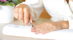 Woman getting a manicure at nail salon in high quality Stock Footage