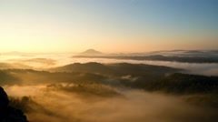 Orange chilly autumn daybreak in hilly landscape. Smooth movement of foggy sea Stock Footage