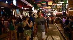 Thai people walking through entertainment district in Chiang Mai Stock Footage