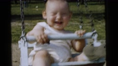 1961: playing in the garden with my mother under her protection  Stock Footage