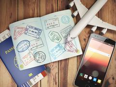 Travel and tourism concept. Passport with visas and boarding passes, airplane Stock Illustration