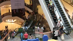 People riding escalators in Central Festival Pattaya Beach mall. Thailand Stock Footage