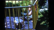 1961: babies playing outside in their crib DETROIT, MICHIGAN Stock Footage