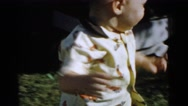 1961: gorgeous day with a lot of play and smiles among brothers Stock Footage