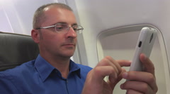 Confident Business Man Browsing Internet Mobile Phone Aircraft Interior Travel Stock Footage