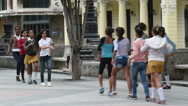 Young latino Cuban girls are dancing on an alley in the central street of Havana Stock Footage