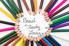 Colouring pencils in circle arrangement with message Read, Study, Learn Stock Photos