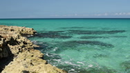 Caribbean Sea coastline at hot summer sunny day. Waves of azure water are Stock Footage