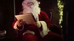 Santa Claus using digital tablet, correcting eyeglasses Stock Footage