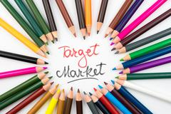 Colouring pencils in circle arrangement with message Target Market Stock Photos