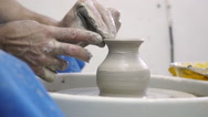 Pottery Master manufactures a vase on a potter's wheel Stock Footage