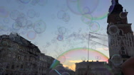 Cloud of soap bubbles on blue sky, public square with happy people - zoom in Stock Footage